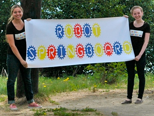 Rachael and Hannah Tipperman holding Robot Springboard sign